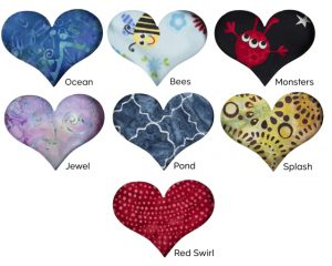 Choose from these seven fabric prints when you buy The Little Heart Pillow™ Gift Set