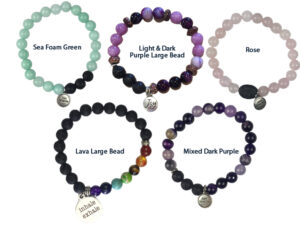 """3's aromatherapy bracelets with charms that say """"Just Breathe"""" and """"Inhale Exhale"""" remind  you to choose calm with deep breathing exercises."""