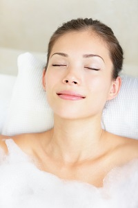 Use these essential oils to create a relaxing aromatherapy bath when you're experiencing PMS