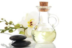 Combine carrier oils and essential oils for skin care to make a bottle of body oil that rejuvenates your skin.