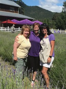 Caryn Gehlmann and Bonnie Rinaldi greet the new owners of Lavender Fields Forever.